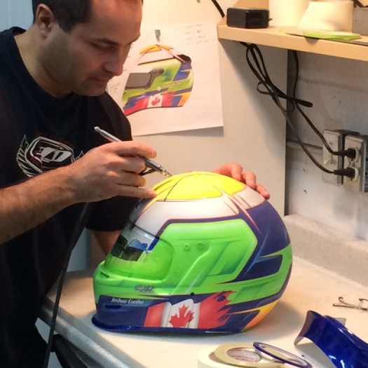 Lyons busy working on his latest lid for a Canadian driver.