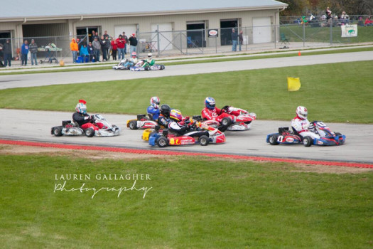 Thompson leads as a big crash erupts behind him (Photo by: Lauren Gallagher Photography)