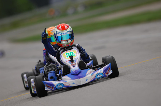 Lachlan DeFrancesco celebrates his victory at the New Castle Motorsports Park (Photo by: OTP.ca)